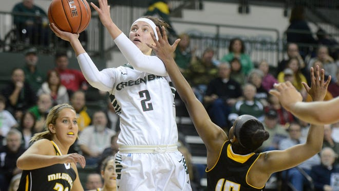 UWGB guard Tesha Buck takes a shot over UW-Milwaukee defenders Jenny Lindner (left) and Sydney Howard in the first half at the Kress Events Center in Green Bay.