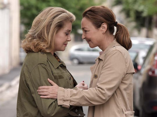 "Claire (Catherine Frot, right) comforts Béatrice (Catherine Deneuve) in ""The Midwife."""