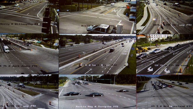 """Martin County Engineering Department project managers for traffic operations monitor intersections in the county in real time on Nov. 17, 2016 at the traffic operations center in Stuart. The screens cycle through different intersections periodically and the videos are not recorded. """"We just wanna see that there's not an incident on the roadways,"""" said Damian Bono, senior project manager."""