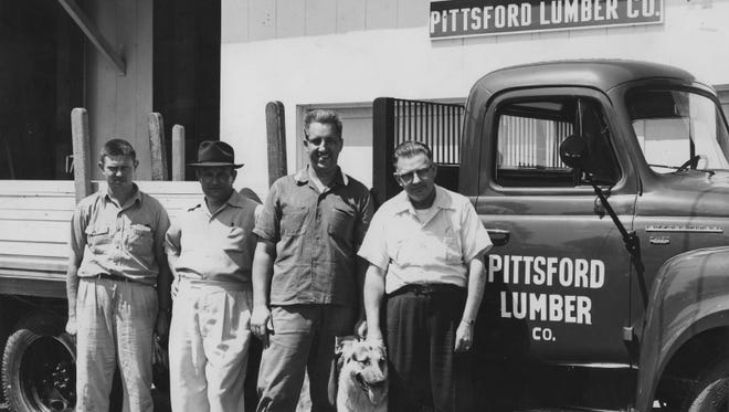 A group of men stand next to a Pittsford Lumber truck in this circa 1950s photo.