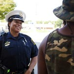 Officer Jennett Vaughn talks with Avondale residents last year.