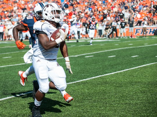 Western Michigan running back Jamauri Bogan, foreground, runs for a touchdown during the first quarter of an NCAA college football game against Illinois, Saturday, Sept. 17, 2016, at Memorial Stadium in Champaign, Ill.  (AP Photo/Bradley Leeb)
