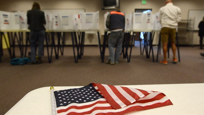 Citizens vote during the 2014 election at the Larimer County Courthouse Building.