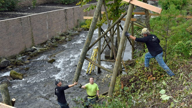 Workers install a sluiceway support system at the Water Wheel Site at Chambersburg Fort on Wednesday, Oct. 5, 2016. From left, are Brandon Stouffer and his brother, Dale Stouffer, right of Brandale General Contractors and Patrick Adams of Brechbill Helman Construction.