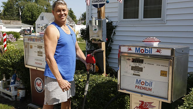 Randy Bronkhorst stands next to one of his vintage gas pumps set up along the driveway of his Fond du Lac home Wednesday August 30, 2017. Bronkhorst collects items that relate to automobiles and memories of his past. Doug Raflik/USA TODAY NETWORK-Wisconsin