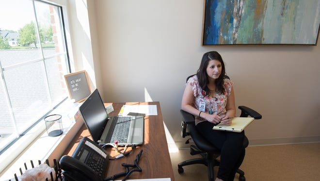Michelle Reyes, LCSW, a licensed clinical social worker and postpartum therapist with Dedicated to Women OBGYN in Dover.