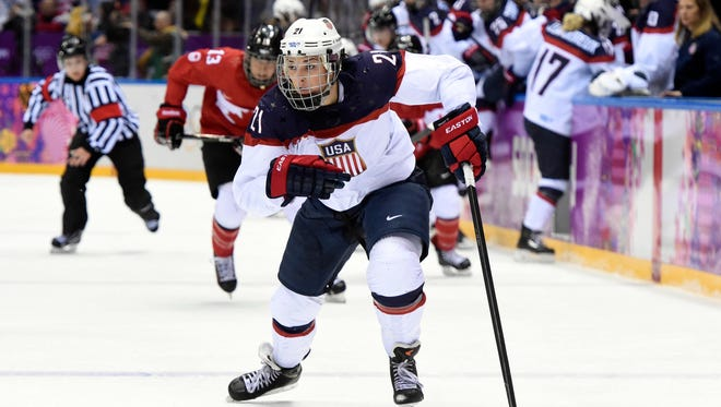 USA forward Hilary Knight (21) skates with the puck against Canada in the women's ice hockey gold medal game during the Sochi 2014 Olympic Winter Games.