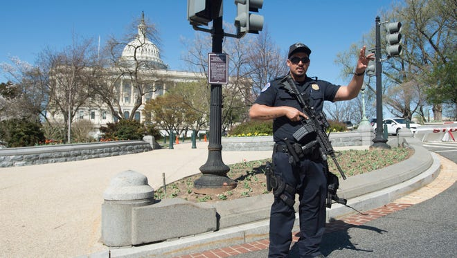 Capitol Police direct pedestrians away in response to a report of shots fired on Capitol Hill,  in Washington DC, USA, 28 March 2016. Reports state that a police officer was injured and a man is now in police custody after gunshots were heard at the Capitol visitor center.