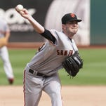 San Francisco Giants starting pitcher Chris Heston (53) throws a pitch against the Oakland Athletics during the sixth inning.
