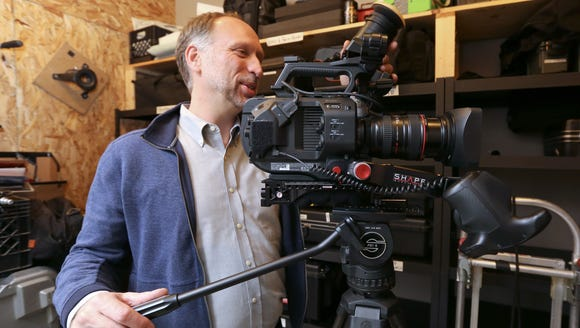 Edward Roy with a video camera at The Cinehub in Beacon