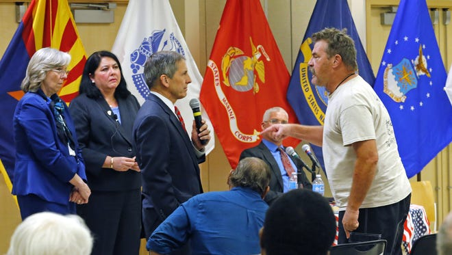 United States Deputy Secretary of Veterans Affairs Sloan D. Gibson gets an earful from cancer patient Dave Van Hook during a town hall event at the Phoenix VA Medical Center Tuesday, Nov. 14, 2016 in Phoenix  Ariz.