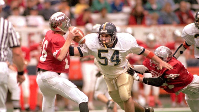Notre Dame's Cory Kilpatrick goes for one of his three sacks against Loudonville in a state playoff game in 1998.
