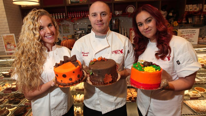 Class event manager Gabrielle Parisi, left, General Manager Mark Sprague and Head Instructor Michelle DeMarco with Thanksgiving and Fall themed fondant layer cakes at Carlo's Bake Shop which offers courses in how to make very colorful, special desserts. Thanksgiving Cake Class is one of a variety of local cooking and baking classes that will help folks prepare their holiday feasts.
