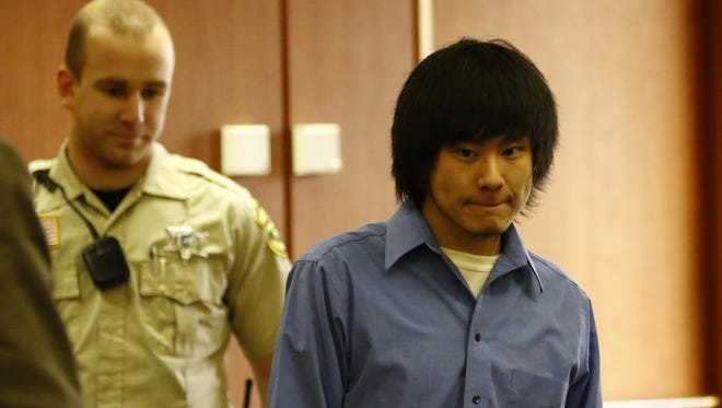 Dylan Yang enters the courtroom during his trial in Wausau.