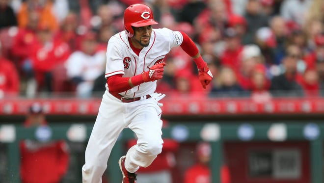 Reds outfielder Billy Hamilton runs to first base.