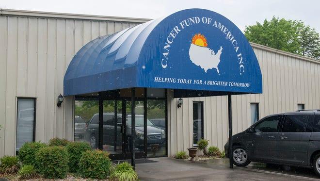In this Monday, May 18, 2015 photo, the headquarters of the Cancer Fund of America is shown in Knoxville, Tenn. A Tennessee man and his family used much of the $187 million it collected for cancer patients through charities such as the Cancer Fund of America to buy themselves cars, gym memberships and take luxury cruise vacations, federal officials alleged Tuesday. (Paul Efird/Knoxville News Sentinel, via AP)