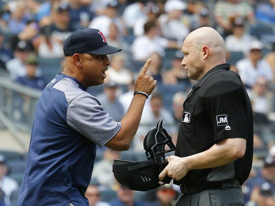 Boston Red Sox manager Alex Cora argues with home plate umpire Mike Estabrook after being ejected.