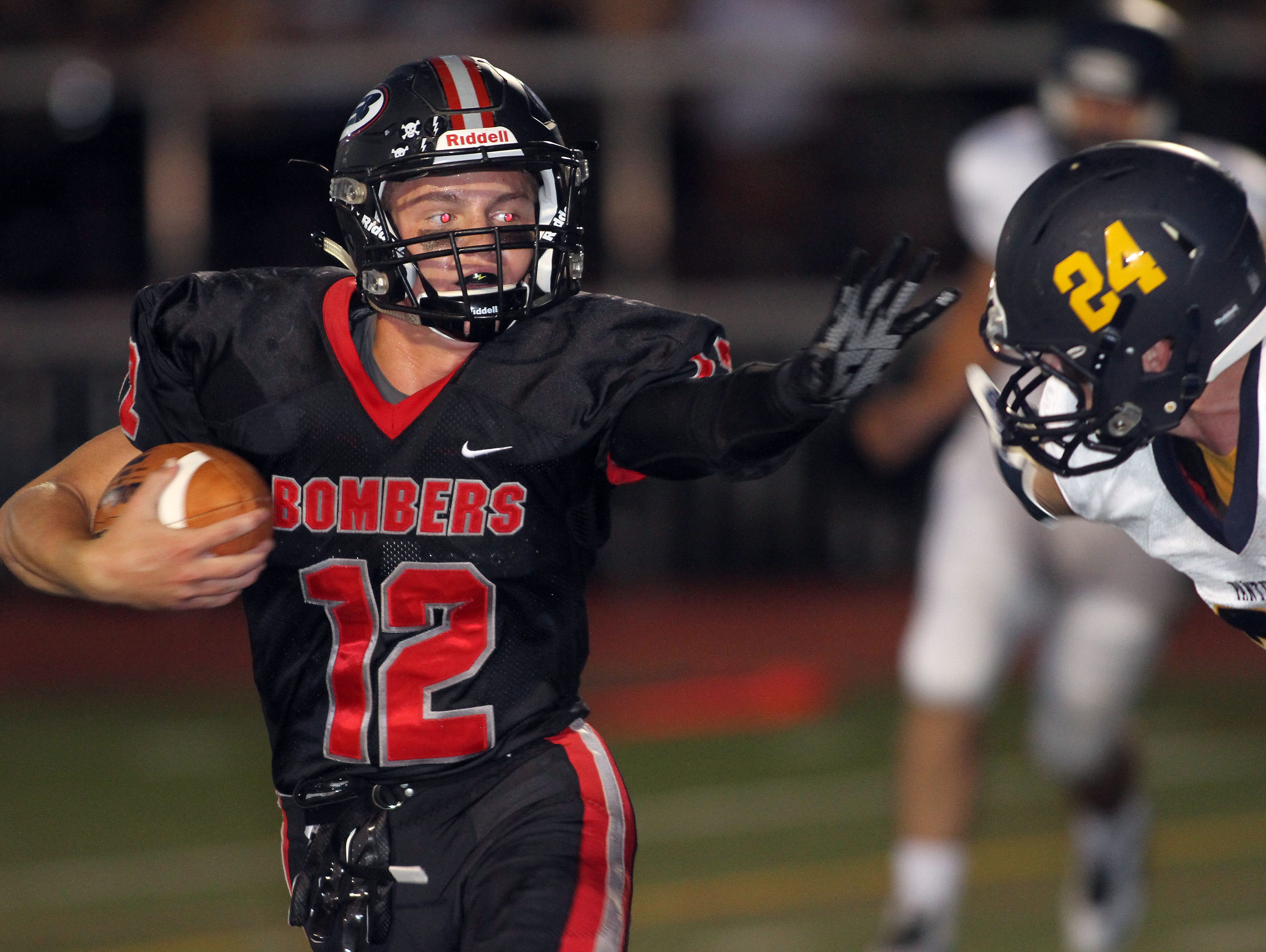 Boonton quarterback Gage Cabalar heads to the end zone for a first half TD vs Pequannock during their Friday night football matchup. September 18, 2015, Boonton, NJ.