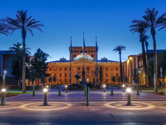 Arizona's State Capitol building lights up at dusk.