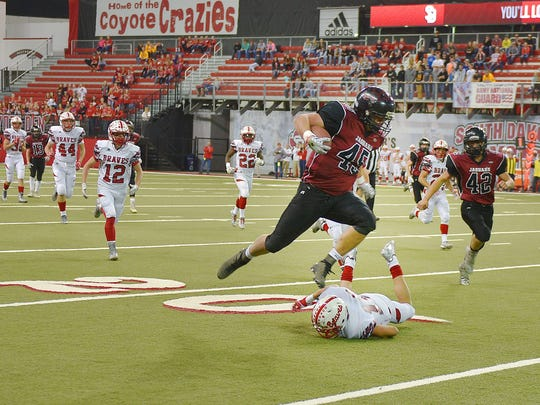 Corsica-Stickney's Cordel Menning leaps over Britton-Hecla to make the first touch down of the game at the DakotaDome Thursday, Nov. 9, in Vermillion.