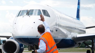 David Barger CEO, President and Director of JetBlue Airways waves off a JetBlue flight bound for NewYork, departing from Burlington International Airport in South Burlington on Friday, August 6, 2010.