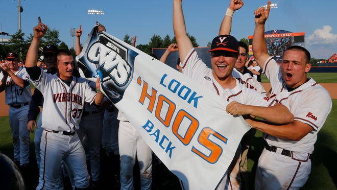 Virginia baseball players celebrate after winning the super regional NCAA college baseball tournament game against Maryland in Charlottesville, Va., Saturday, June 6, 2015. Virginia won the game 5-4. (AP Photo/Steve Helber)