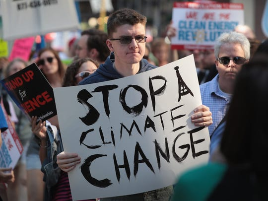 Demonstrators protest President Donald Trump's decision to exit the Paris climate change accord on June 2, 2017 in Chicago.