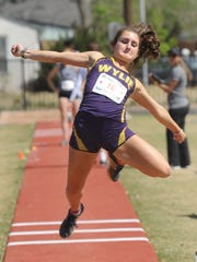 Wylie's Madison Latham competes in the girls long jump at the Region I-4A track and field meet Friday at Lowrey Field in Lubbock. She finished fifth with a leap of 17 feet, 11/4 inches.