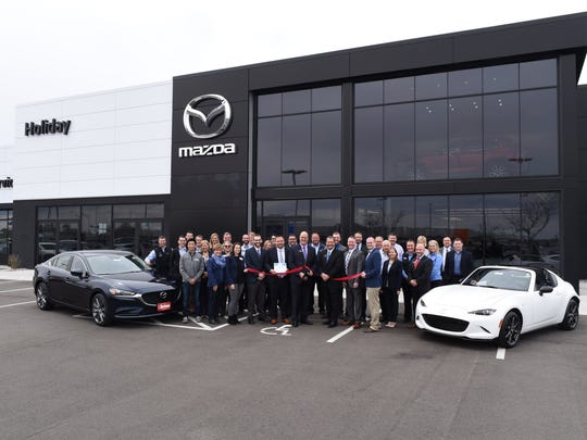 Holiday Mazda staff and leadership were joined by representatives