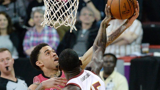 Erie BayHawks guard Josh Gray, left, has a shot blocked by Canton Charge guard Sir'Dominic Pointer during an NBA G League basketball game at Erie Insurance Arena on March 7, 2020, in Erie.
