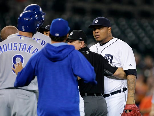 Tigers pitcher Bruce Rondon and Royals' Mike Moustakas