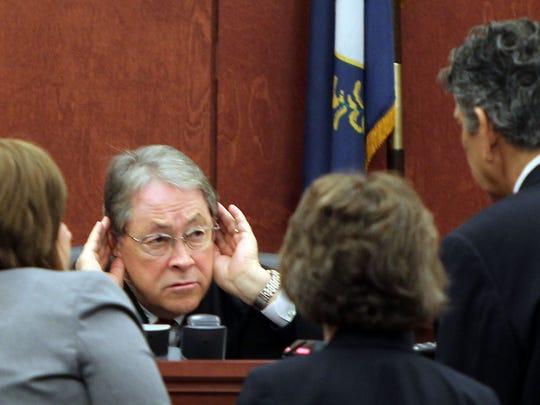 Campbell Circuit Judge Fred Stine listens during a