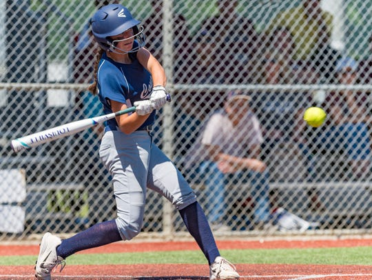 St. Thomas More's Madison Prejean takes a swing during a game last season against University High in the state semifinals in Sulphur.