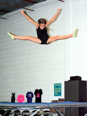 Rynlee Sedillo, 7, works on toe touch drills on a trampoline on Wednesday. Sedillo's mother, TaNessa, recently opened up Cheer & Tumble Athletics.