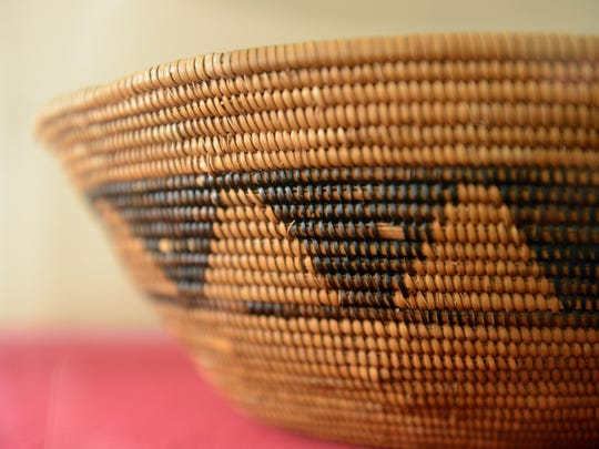 A Chumash woven bowl on loan from the Santa Barbara Museum of Natural History is one of the items of display at the Chumash Indian Museum in Thousand Oaks, which has temporarily closed.