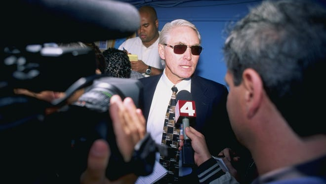 Fred Claire, then general manager of the Los Angeles Dodgers , talks to the media at the start of the 1998 season, his last as general manager of the team.
