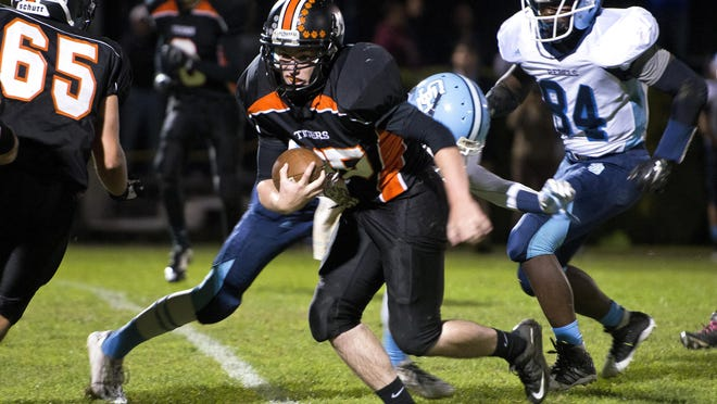 Middlebury's Parker Gross (35) carries the ball during the third quarter of Friday's high school football game against South Burlinton in Middlebury.