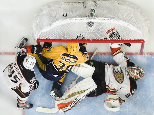 Anaheim Ducks goalie John Gibson (36) lets a goal by Nashville Predators left wing Filip Forsberg slip past as left wing Viktor Arvidsson (38) crashes the net during the third period of game 3 of the Western Conference finals at Bridgestone Arena Tuesday, May 16, 2017 in Nashville, Tenn.