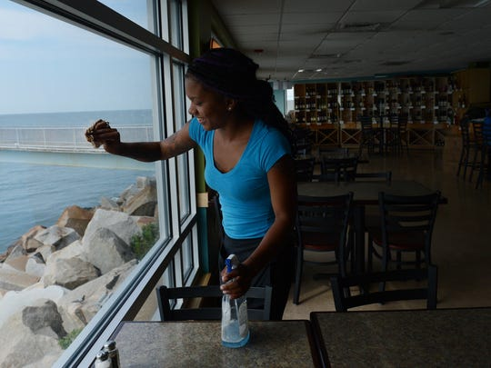 Ciara Spady of Norfolk, cleans one of the many windows overlooking the Chesapeake Bay at Virginia Originals & Chesapeake Grill between the lunch and dinner rush on Wednesday, Aug. 31, 2016. The restaurant at the southern most island of the Chesapeake Bay Bridge-Tunnel facility offers a unique dining experience, however the restaurant and an adjacent fishing pier will close in a little more than a year to make way for construction of a new tunnel tube at the site. The pier will reopen after construction, the restaurant will not.