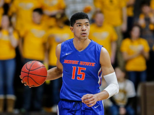Boise State Broncos guard Chandler Hutchison controls