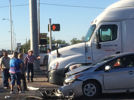 The Toyota Prius ran a red light, hit a motorcycle
