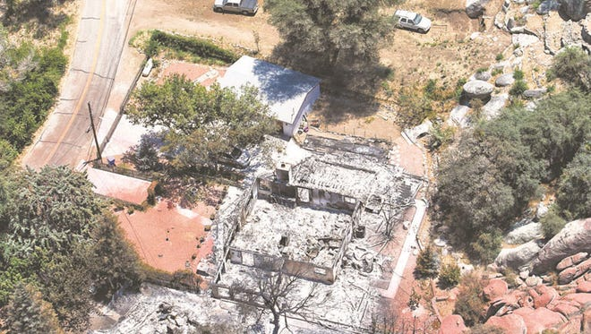 Removing landscape debris, such as the burned trees in Yarnell, probably will require extra coverage at added cost.
