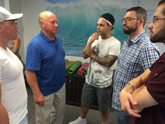 Peter Pisar speaks with members of the New Brunswick Chapter of Young People in Recovery.