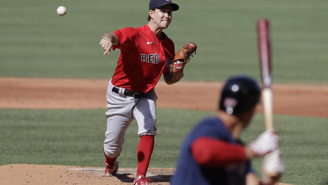 Red Sox pitcher Ryan Weber, who is striving to make the club's starting rotation, delivers to the plate during the intrasquad game held Thursday afternoon at Fenway Park.