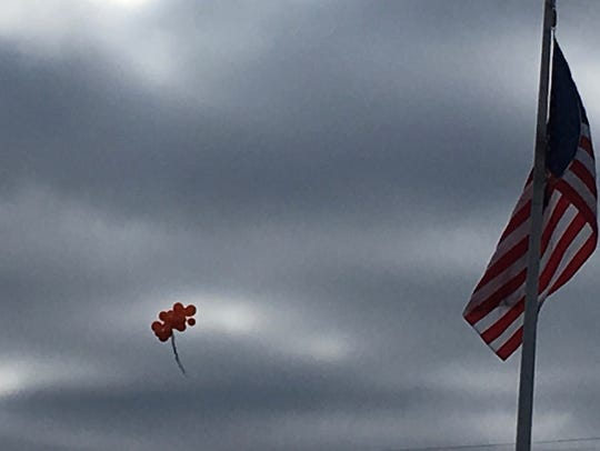 Balloons were launched Wednesday at Okemos High School