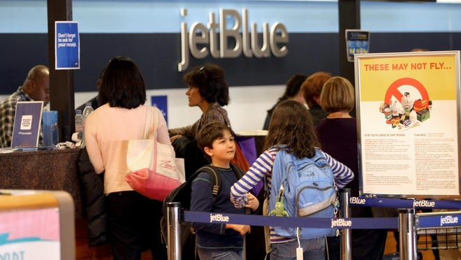 View of passengers at the checking counter for Jet Blue in this 2010 photo at Palm Beach International Airport  in West Palm Beach.