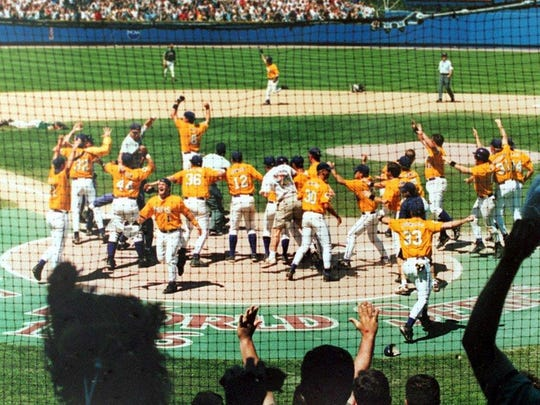 Warren Morris rounds the bases as his LSU teammates celebrate at home plate following Morris' walk-off home run to win the 1996 College World Series.