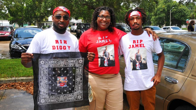 Jamel's aunt and cousins, Pamela Dobbs, Toby Hearns and Capone Dunn, all worn t-shirts wtih Jamel on them. Hundreds attended the funeral for Jamel Dunn on Saturday afternoon at the Zion Orthodox Primitive Baptist Church in Cocoa. Many wore traditional dark clothing, while many wore red at the request of the family. Dunn's death gained international attention when video of teens callously filmed his drowning July 9th while mocking him.