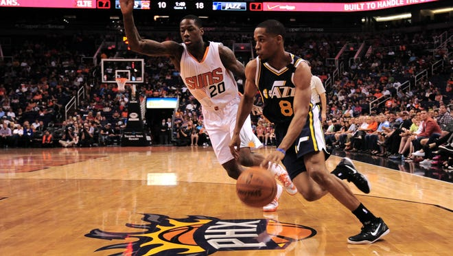 April 4, 2015; Phoenix; Utah Jazz guard Bryce Cotton (8) dribbles past Phoenix Suns guard Archie Goodwin (20) during the first half at US Airways Center.
