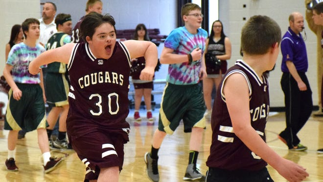 Stuarts Draft High School student Matthew Lawson celebrates after scoring a basket during a charity basketball game with students from Wilson Memorial on Friday, March 24, 2017, at Stuarts Draft High School. The proceeds from the game benefitted the Augusta County Public Schools' adaptive physical education program.